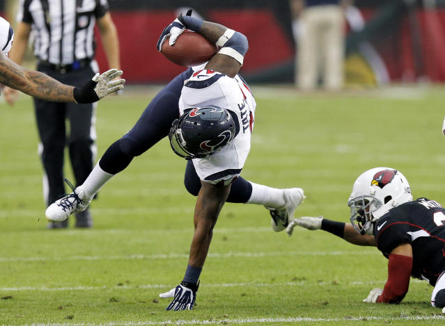 Houston Texans running back Ben Tate, left, is tackled by Arizona Cardinals free safety Tyrann Mathieu, right, during the first half of an NFL football game Sunday, Nov. 10, 2013, in Glendale, Ariz. (AP Photo/Ross D. Franklin)