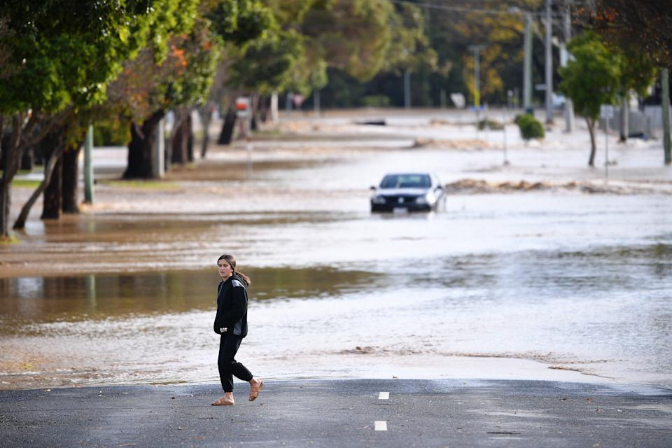 A person is seen observing the flood water in Traralgon. Source: AAP