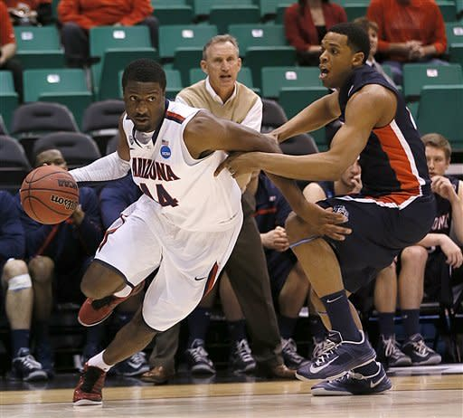 Arizona's Solomon Hill, left, drives to the basket past Belmont's Blake Jenkins during the first half of a second-round game in the NCAA college basketball tournament in Salt Lake City Thursday, March 21, 2013. (AP Photo/George Frey)