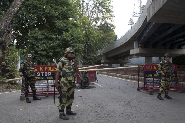 Border Security Force soldiers stand guard at a temporary check post during curfew in Srinagar, Indian controlled Kashmir, Wednesday, Aug. 7, 2019. Authorities in Hindu-majority India clamped a complete shutdown on Kashmir as they scrapped the Muslim-majority state's special status, including exclusive hereditary rights and a separate constitution, and divided it into two territories. (AP Photo/Dar Yasin)