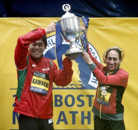 Apr 16, 2018; Boston, MA, USA; 2018 Boston Marathon winners Yuki Kawauchi of Japan (left) and Desiree Linden of the USA hold up the trophy after their wins. Mandatory Credit: Winslow Townson-USA TODAY Sports