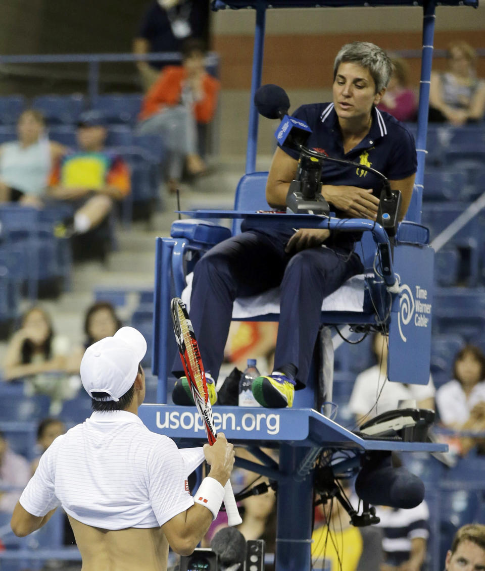FILE - In this Sept. 2, 2014, file photo, Japan's Kei Nishikori questions a call from umpire Marija Cicak during a match against Milos Raonic of Canada in the fourth round of the 2014 U.S. Open tennis tournament in New York. There will be a female chair umpire for the Wimbledon men's singles final for the first time in the history of a tournament first played in 1877. Cicak, the 43-year-old from Croatia, will officiate Sunday, July 11, 2021, when Novak Djokovic faces Matteo Berrettini for the championship at the All England Club. (AP Photo/Darron Cummings, File)