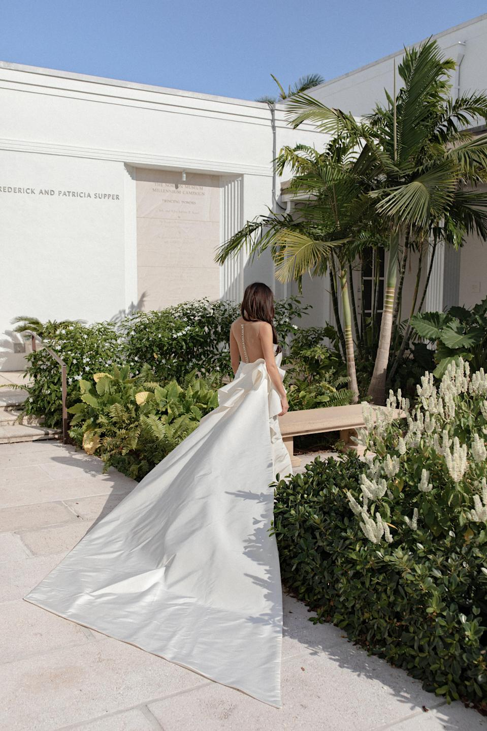 The back of my dress was 10 feet long. It had a detachable train cut on a bias and designed to match the minimalist sculptures in the garden. I loved the drama of it all.
