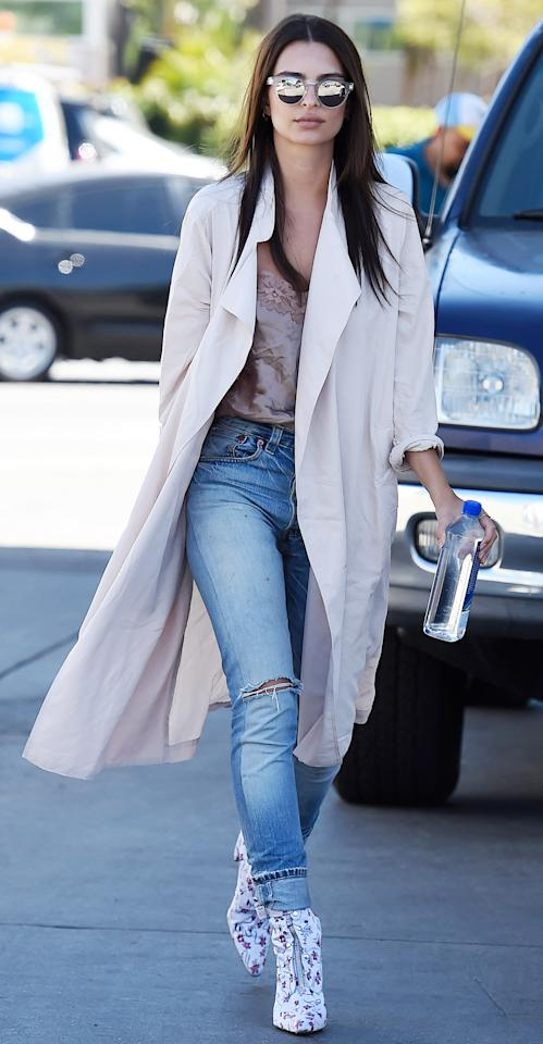 """<p>EmRata maintained her street style legacy while out and about in L.A. dressed in a silky taupe camisole, ripped light-wash jeans, her go-to beige duster (shop a similar topper <a rel=""""nofollow"""" href=""""https://click.linksynergy.com/fs-bin/click?id=93xLBvPhAeE&subid=0&offerid=293189.1&type=10&tmpid=12370&RD_PARM1=http%3A%2F%2Fwww.barneys.com%2Fproduct%2Fulla-johnson-maude-twill-trench-coat-505018458.html%3Futm_source%3Dpolyvore%2526utm_medium%3Daffiliate%2526utm_campaign%3Ddesktop_coats&u1=ISEmRataSSTrenchIJMarch"""">here</a>), and a pair of statement-making zip-front floral booties (shop a similar pair <a rel=""""nofollow"""" href=""""https://click.linksynergy.com/fs-bin/click?id=93xLBvPhAeE&subid=0&offerid=391008.1&type=10&tmpid=16680&RD_PARM1=https%3A%2F%2Fwww.anthropologie.com%2Fshop%2Fpaco-gil-embroidered-floral-boots%3Fcm_mmc%3DCSE-_-Polyvore-_-US-_-Boots-desktop%2526utm_campaign%3DCSE%2526utm_content%3D41602947%2526utm_medium%3DPolyvore%2526utm_source%3DBoots&u1=ISEmrataSSFloralBootsIJMarch"""">here</a>).</p>"""