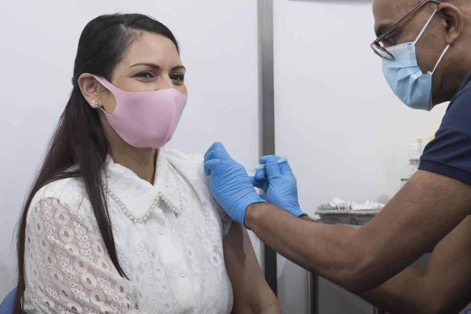 Britain's Home Secretary Priti Patel receives her first dose of the Moderna Covid-19 vaccine from Dr. Vin Diwakar at Guys Hospital in London, Saturday May 15, 2021. (Stefan Rousseu/PA via AP)