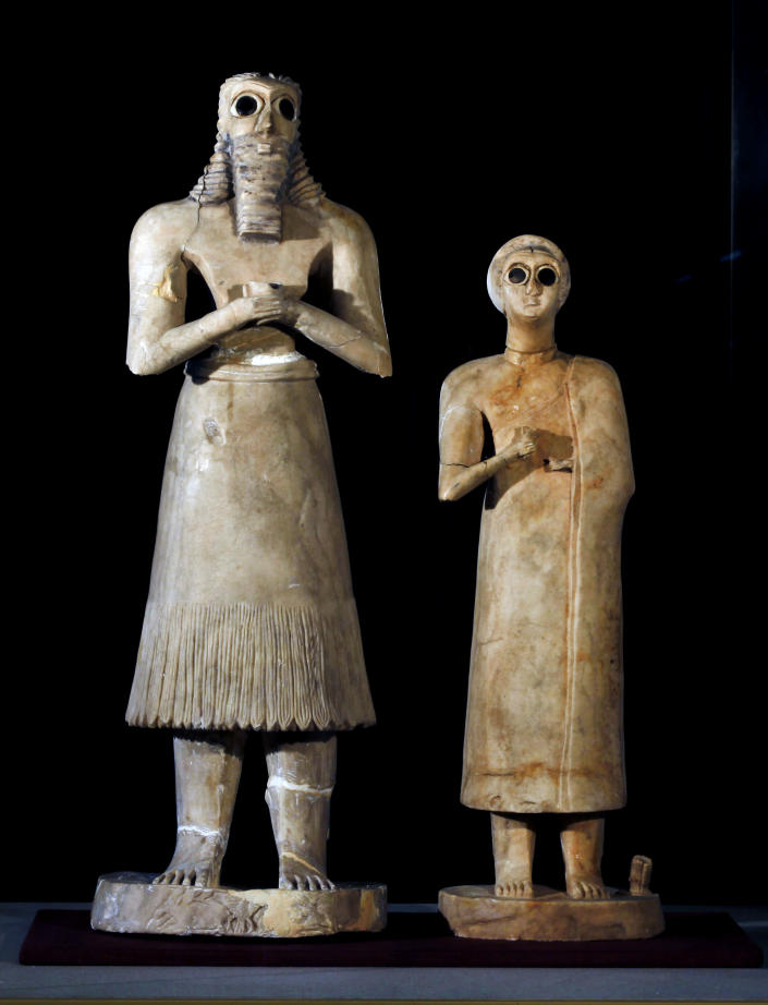 Recovered statues are displayed at the Iraqi National Museum in Baghdad, Iraq, Monday, April 1, 2013. Tens of thousands of artifacts chronicling some 7,000 years of civilization in Mesopotamia are believed to have been looted from Iraq in the chaos which followed the the US-led invasion in 2003. Despite international efforts to track items down, fewer than half of the artifacts have so far been retrieved. (AP Photo/Hadi Mizban)