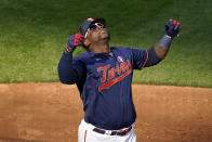 Minnesota Twins' Miguel Sano celebrates his three-run home run off Oakland Athletics pitcher Jake Diekman in the eighth inning of a baseball game, Saturday, May 15, 2021, in Minneapolis. (AP Photo/Jim Mone)