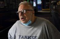 Joe Bastone, owner of Yankee Tavern, responds to questions during an interview Friday, Aug. 14, 2020, in New York. Bastone is expecting to lose about $500,000 in revenue this season -- losses unlike anything the 93-year-old bar has previously survived. (AP Photo/Frank Franklin II)