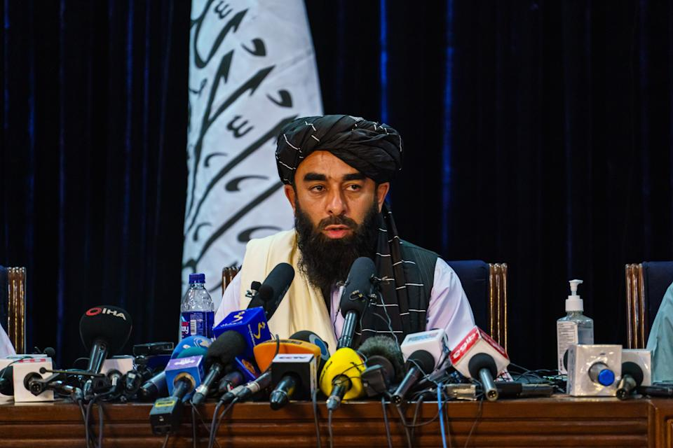 Zabihullah Mujahid, the Taliban spokesman for nearly two decades who worked in the shadows, makes his first-ever public appearance. Source: Getty