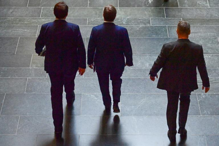 Candidate for Chancellor Armin Laschet (C) leaves the the Bundestag after his CDU-CSU conservative alliance brought home its worst election result in post-war Germany (AFP/John MACDOUGALL)