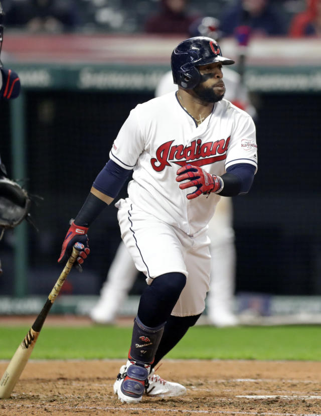 Cleveland Indians' Carlos Santana watches his ball after hitting an RBI-single off Atlanta Braves starting pitcher Touki Toussaint in the second inning during the second game of a baseball doubleheader, Saturday, April 20, 2019, in Cleveland. Leonys Martin scored on the play. (AP Photo/Tony Dejak)