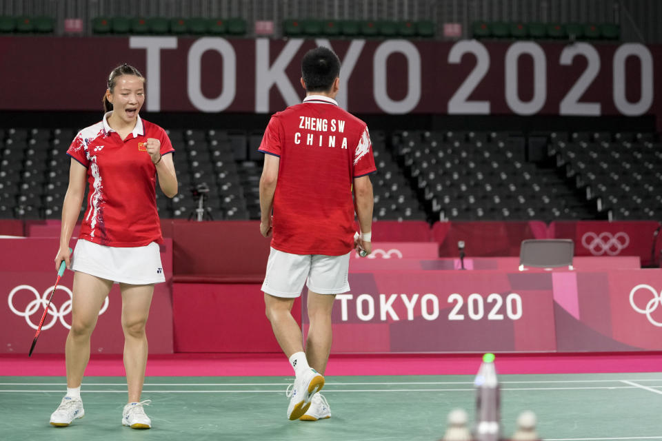 China's Zheng Si Wei and Huang Ya Qiong, left, celebrates a point during their mixed doubles semi-final match against Hong Kong's Tang Chun Man and Tse Ying Suet at the 2020 Summer Olympics, Thursday, July 29, 2021, in Tokyo, Japan. (AP Photo/Markus Schreiber)