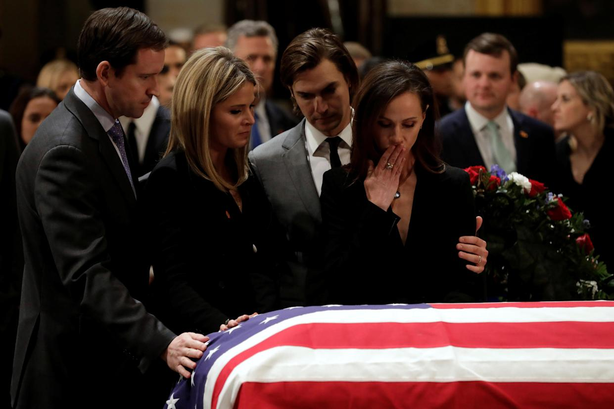 Family members stand at the flag-draped casket of former U.S. President George H.W. Bush as it lies in state inside the U.S. Capitol Rotunda in Washington,D.C., Dec. 4, 2018. (Photo: Yuri Gripas/Reuters)