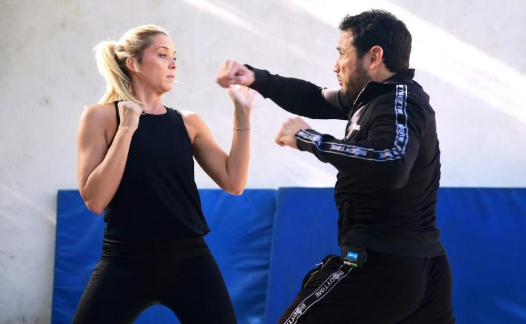 "Stuntman Daniel Locicero (R) works out with actress Courtney M. Moore -- he says an Oscar win for Brad Pitt for his role as a laid-back stuntman in ""Once Upon a Time... in Hollywood"" would bring good exposure to the profession"