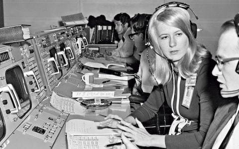 Poppy Northcutt, pictured at Nasa's Mission Control 1969, helped to design the trajectories for Apollo 11's return to Earth - Credit: GETTY IMAGES