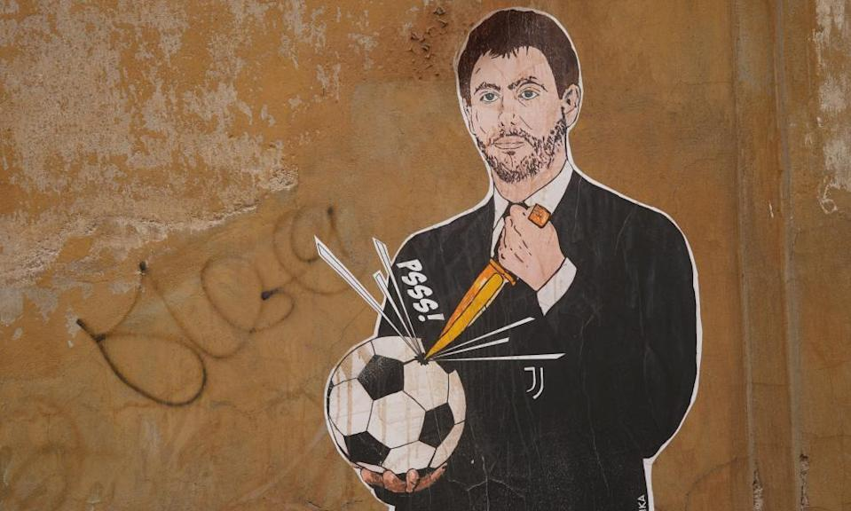 A mural showing Juventus president Andrea Agnelli making a hole in a football with a knife.