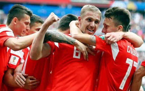 Russia's Yuri Gazinsky celebrates with teammates after scoring his side's first goal  - Credit: AP Photo/Matthias Schrader
