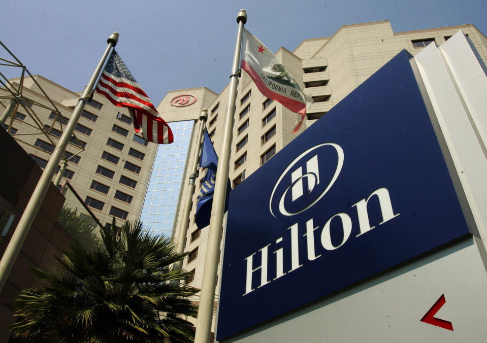 <p> FILE - In this Tuesday, July 31, 2007, file photo, flags fly outside the Hilton Hotel in Long Beach, Calif., The hotelier, which went private in 2007, priced its initial public offering on Wednesday, Dec. 11, 2013 at $20 per share in the middle of its expected range, for a total take of $2.35 billion on the sale of 117.6 million shares. (AP Photo/Reed Saxon, File)</p>