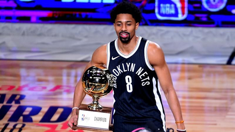 Spencer Dinwiddie poses with the Skills Challenge Trophy after winning the competition on Saturday night at Staples Center.