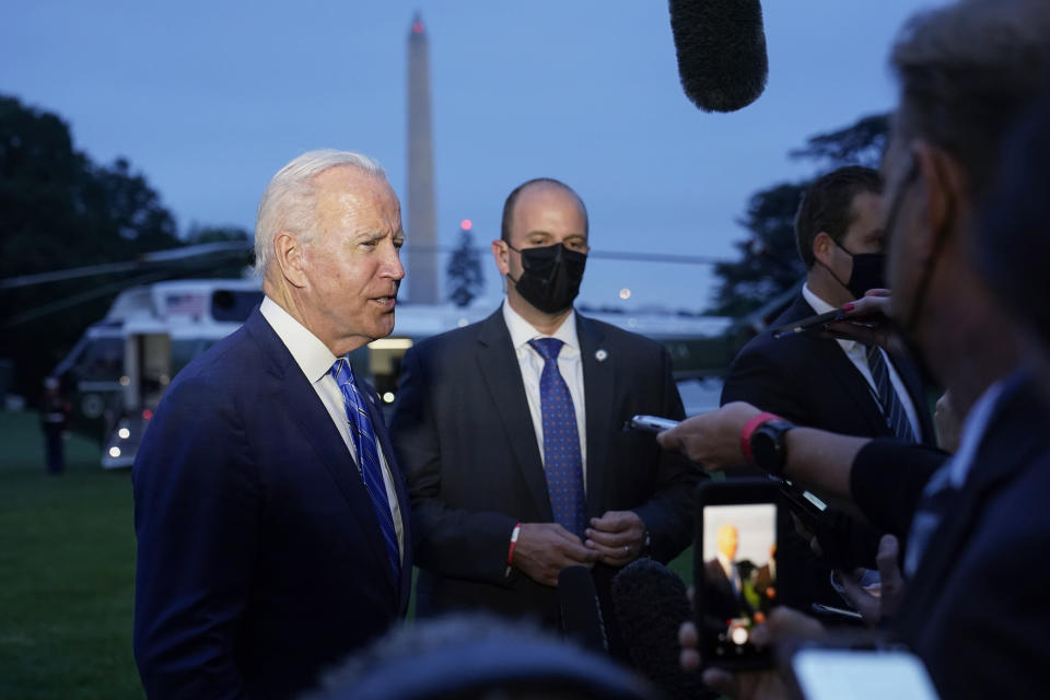 President Joe Biden talks with reporters after returning to the White House in Washington, Tuesday, Oct. 5, 2021, after a trip to Michigan to promote his infrastructure plan. (AP Photo/Susan Walsh)