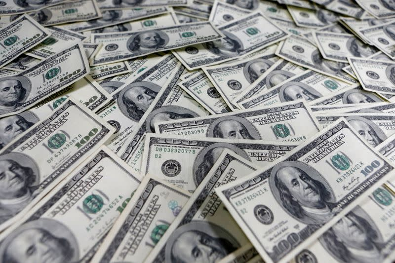 U.S. dollar gains as global easing gives temporary respite