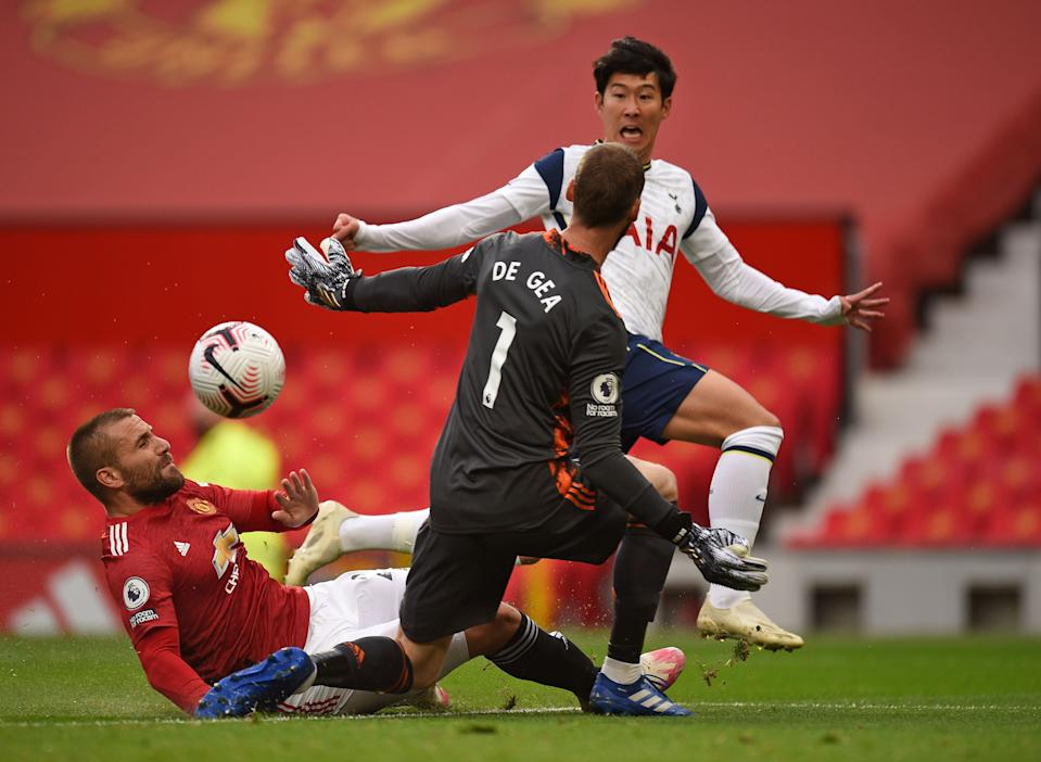 Tottenham Hotspur's South Korean striker Son Heung-Min (back) shoots to scores his team's second goal past Manchester United's Spanish goalkeeper David de Gea (C) during the English Premier League football match between Manchester United and Tottenham Hotspur at Old Trafford in Manchester, north west England, on October 4, 2020. (Photo by Oli SCARFF / AFP) / RESTRICTED TO EDITORIAL USE. No use with unauthorized audio, video, data, fixture lists, club/league logos or 'live' services. Online in-match use limited to 120 images. An additional 40 images may be used in extra time. No video emulation. Social media in-match use limited to 120 images. An additional 40 images may be used in extra time. No use in betting publications, games or single club/league/player publications. / (Photo by OLI SCARFF/AFP via Getty Images)