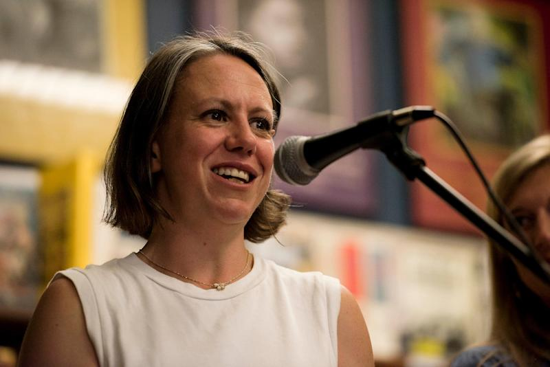 """Hillary Frey introduces journalist Curtis Wilkie, who will interview Mayor Robyn Tannehill during the """"What Makes Oxford Work""""€ event at the Off Square Books store in Oxford."""