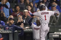 Minnesota Twins' Nick Gordon (1) celebrates his two-run home run off Chicago Cubs starting pitcher Alec Mills, with manager Rocco Baldelli, left, and Miguel Sano as he enters the dugout during the fourth inning of a baseball game Tuesday, Sept. 21, 2021, in Chicago. (AP Photo/Charles Rex Arbogast)