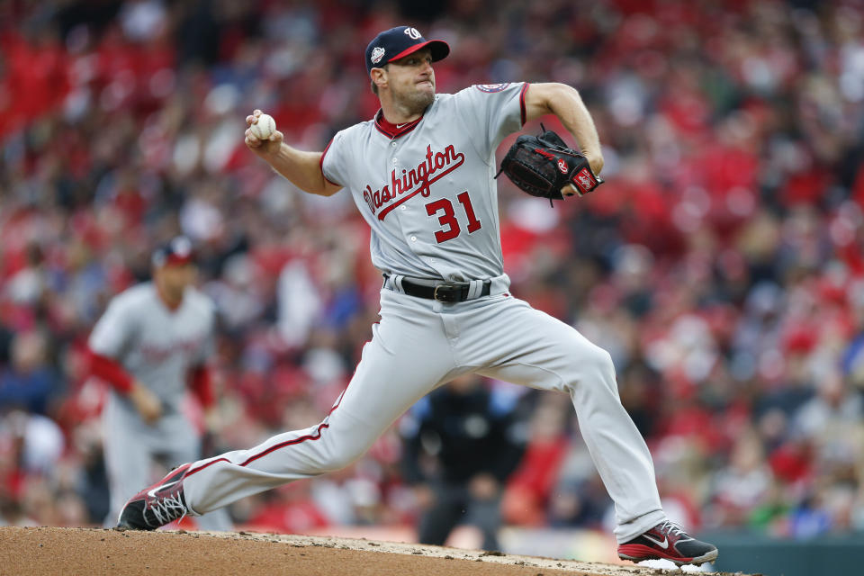 Washington Nationals starting pitcher Max Scherzer throws in the third inning of an opening day baseball game against the Cincinnati Reds, Friday, March 30, 2018, in Cincinnati. (AP Photo/Gary Landers)