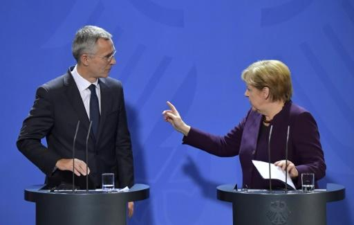 German Chancellor Angela Merkel (R) and NATO Secretary-General Jens Stoltenberg have taken issue with French President Emmanuel Macron's description of NATO as undergoing 'brain death'