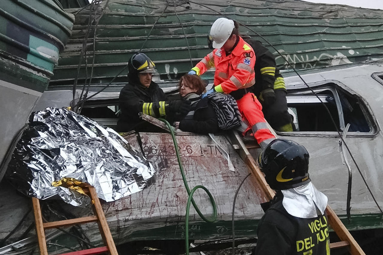 <p>A woman is helped out of the wrecked car of a train that derailed at the station of Pioltello Limito, on the outskirts of Milan, Italy, Thursday, Jan. 25, 2018. (Photo: AP) </p>