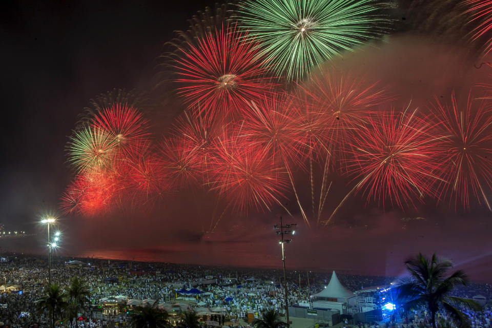 Fireworks explode over Copacabana Beach during the New Year's celebrations, in Rio de Janeiro, Brazil, Wednesday, Jan. 1, 2020. (AP Photo/Bruna Prado)