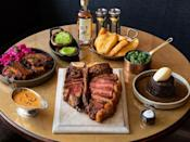"""<p>Enjoy a veritable feast together by serving up Hawksmoor's delicious dry-aged porterhouse steak, Old Spot Belly ribs, garlicky mushrooms and the best home-oven chips you'll ever taste, alongside a spoiling sticky toffee pudding with clotted cream and potent Johnnie Walker Old Fashions and Ginza Highballs. Perfection!</p><p><a href=""""https://shop.thehawksmoor.com/"""" rel=""""nofollow noopener"""" target=""""_blank"""" data-ylk=""""slk:Hawksmoor at Home"""" class=""""link rapid-noclick-resp"""">Hawksmoor at Home</a> boxes, from £110.</p>"""
