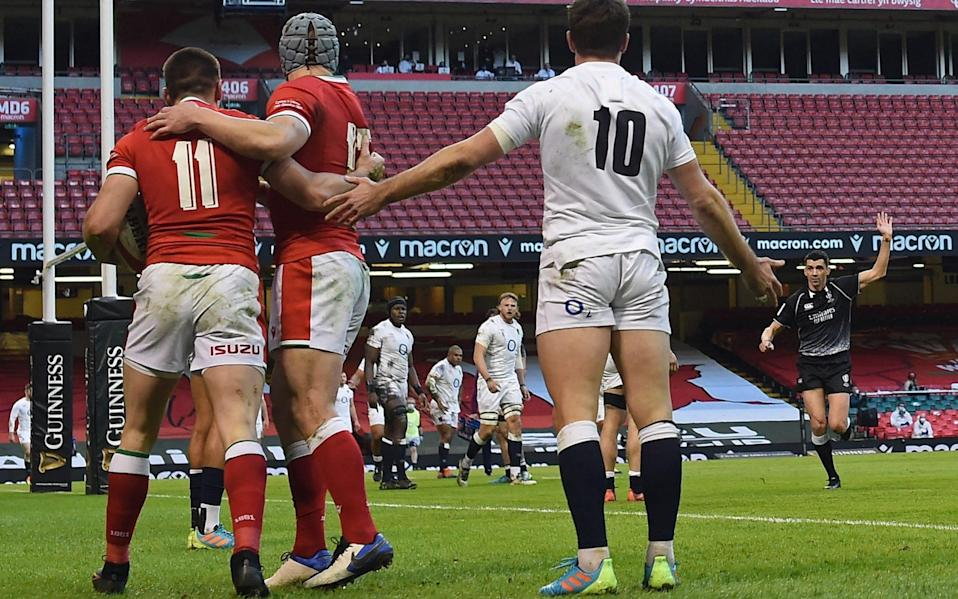 Referee Pascal Gauzere awards the Josh Adams try as George Ford protests - AFP