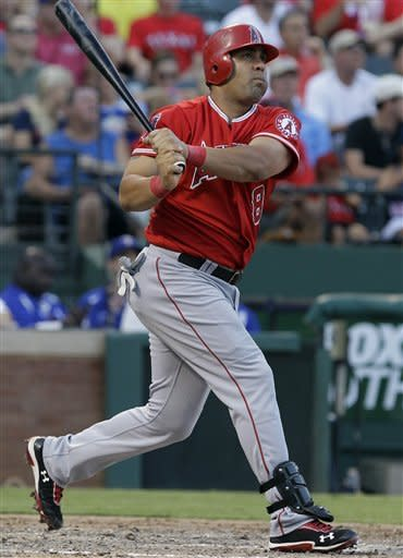 Los Angeles Angels designated hitter Kendrys Morales watches his two-run homer hit as a lefty fly away during the sixth inning of baseball game against the Texas Rangers Monday, July 30, 2012, in Arlington, Texas. Alberto Pujols scored on the play. (AP Photo/LM Otero)