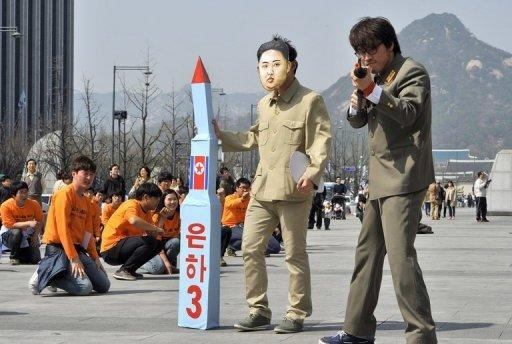 A South Korean activist (C) wearing a mask of North Korean leader Kim Jong-Un holds a mock missile during a rally in Seoul in April 2012 denouncing North Korea's rocket launch. The official position of the North is that it needs nuclear weapons for self-defence against a US nuclear threat, but that it is willing in principle to scrap them