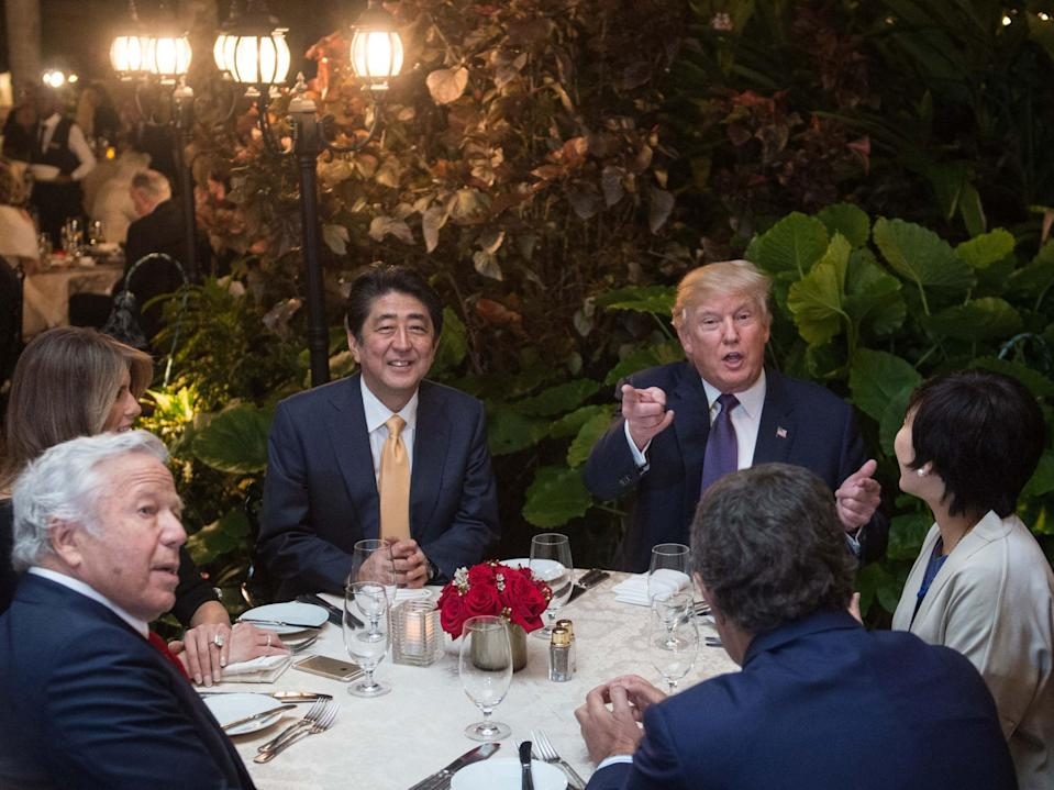 Donald Trump, with Japan Prime Minister Shinzo Abe, his wife, Melania Trump, and New England Patriots owner Robert Kraft, in Mar-a-Lago (AFP/Nicholas/Kamm/Getty)