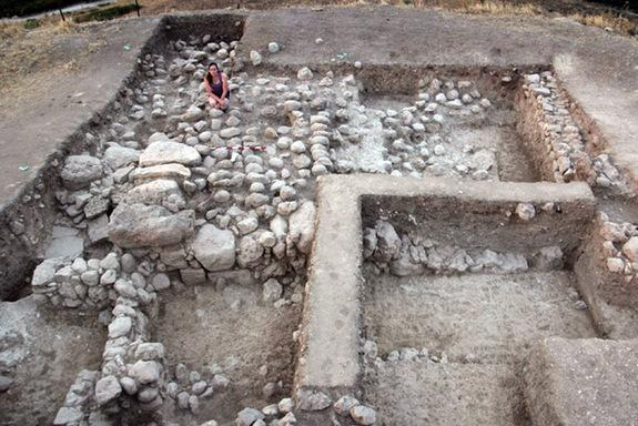 """The jug with treasure was found just to the north of a """"massive structure,"""" as the researchers call it, which may be a tower overlooking a valley. At some point the massive structure fell into disuse and domestic dwellings were built to the nor"""