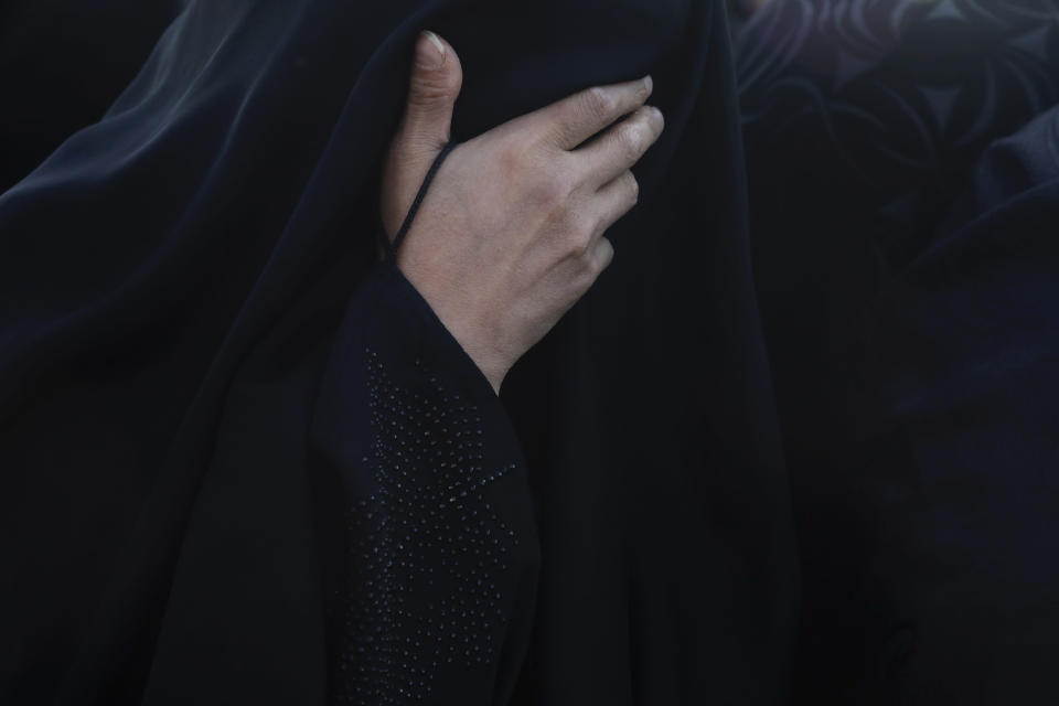 A relative weeps during a funeral procession for a oved one, a Covid-19 victim, at Behesht-e-Masoumeh cemetery just outside the city of Qom, some 80 miles (125 kilometers) south of the capital Tehran, Iran, Wednesday, Sept. 15, 2021. (AP Photo/Vahid Salemi)