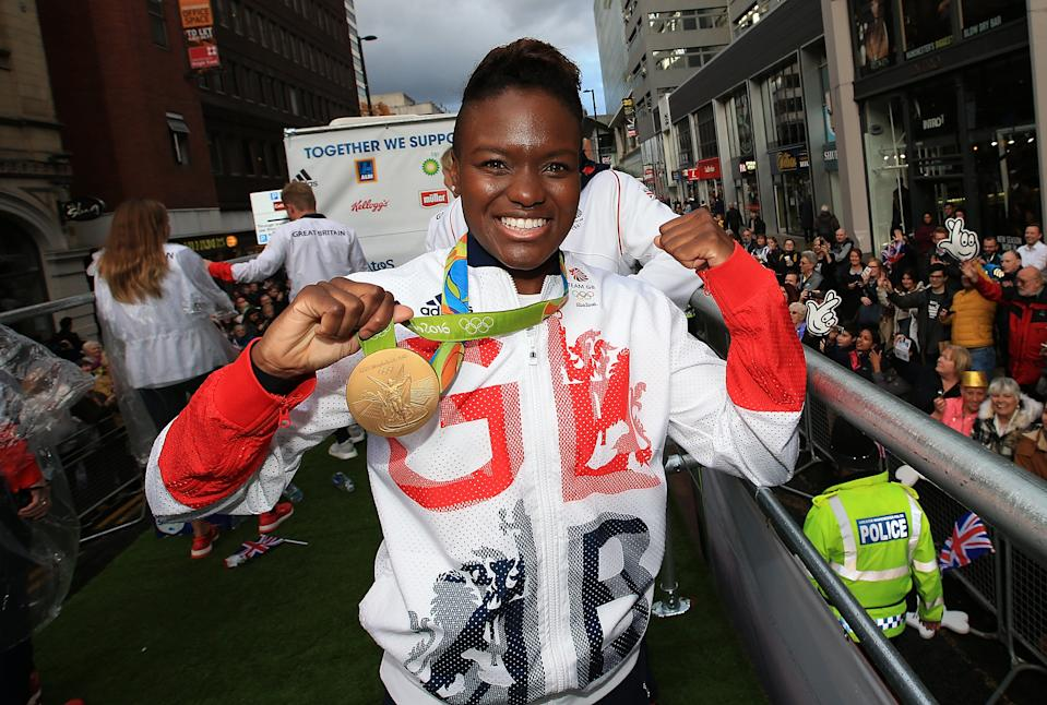 MANCHESTER, ENGLAND - OCTOBER 17:  Nicola Adams poses with her gold medal during the Olympics & Paralympics Team GB - Rio 2016 Victory Parade on October 17, 2016 in Manchester, England.  (Photo by Jan Kruger/Getty Images)