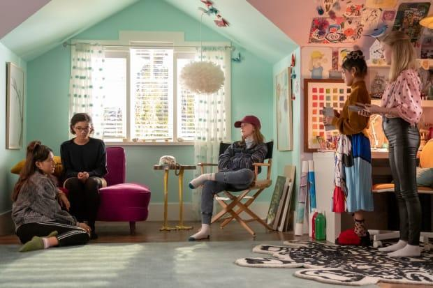 (L–R) Dawn (Xochitl Gomez), Mary Anne (Malia Baker), Kristy (Sophie Grace), Claudia Kishi (Momona Tamada) and Stacey (Shay Rudloph) wait for the landline to ring. Note the shoe-free Kishi household.