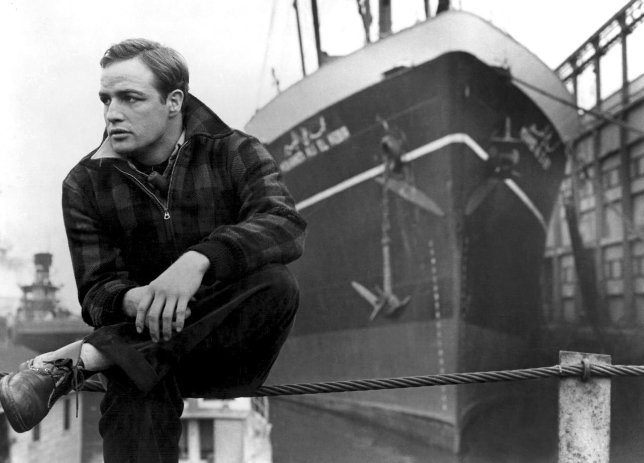 "<a href=""https://ew.com/article/2013/02/15/waterfront/""><em>On the Waterfront</em></a> tells the tale of Terry Malloy (<a href=""http://ew.com/tag/marlon-brando"">Marlon Brando</a>), a boxer-turned-longshoreman whose guilty conscience slowly turns him against the mob-connected union leader who rules the docks. The Oscar-winning classic also had its roots in a different sort of whistleblowing: At the height of the McCarthy era, <em>Waterfront</em> director Elia Kazan became a pariah in Hollywood for naming former Communists to the House Un-American Activities Committee. This film is often viewed as Kazan's response to his detractors, and the parallels aren't hard to spot."
