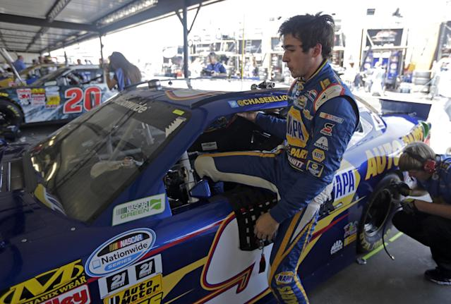 Chase Elliott climbs from his car after a NASCAR auto race practice at the Darlington Speedway in Darlington, S.C., Thursday, April 10, 2014. While Dale Earnhardt Jr. fights to get out front in the Sprint Cup series, he's already on top in the Nationwide circuit as his JR Motorsports drivers Chase Elliott and Regan Smith stand 1-2 in the standings heading into Friday night's event at Darlington Raceway. (AP Photo/Chuck Burton)
