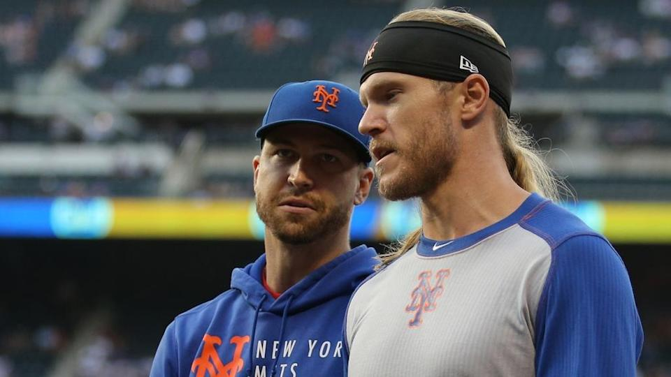 New York Mets injured starting pitchers Jacob deGrom (left) and Noah Syndergaard walk in from the bullpen before a game against the Atlanta Braves at Citi Field.