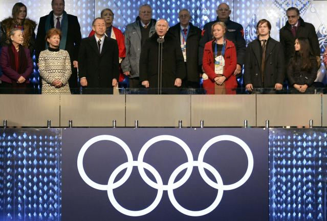 Russian President Vladimir Putin (C) declares the Olympic Games open during the opening ceremony of the 2014 Sochi Winter Olympics at the Fisht Olympic Stadium in Sochi February 7, 2014. United Nations (U.N.) Secretary-General Ban Ki-moon stands on his right. REUTERS/Jung Yeon-Je (RUSSIA - Tags: SPORT OLYMPICS)