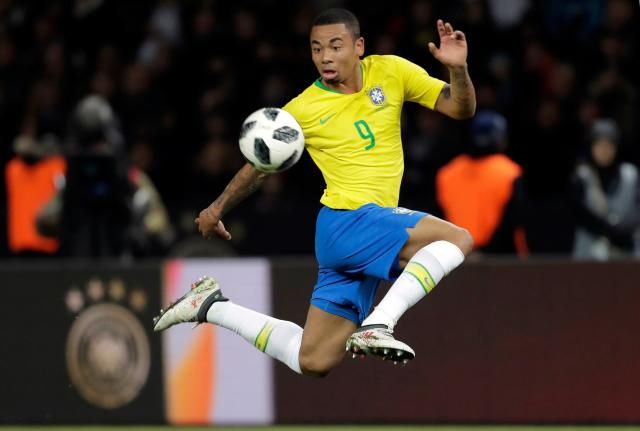 In this photo taken on Tuesday, March 27, 2018, Brazil's Gabriel Jesus controls the ball during the international friendly soccer match between Germany and Brazil in Berlin. At the World Cup four years ago, Colombia forward James Rodriguez became one of the stars of the tournament and shot to international fame with his trickery on the ball and eye for a spectacular goal. Here's a look at young players hoping to make a similar impact at this year's World Cup in Russia. Among them is France left back Benjamin Mendy, Spain midfielder Marco Asensio, Belgium winger Leroy Sane, and Brazil striker Gabriel Jesus. (AP Photo/Markus Schreiber)