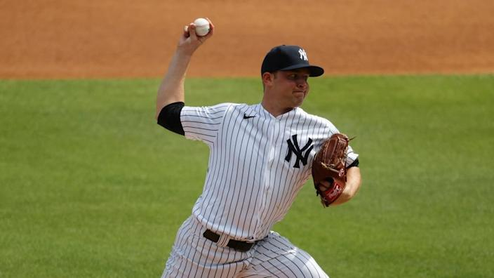Michael King fires pitch during spring training start
