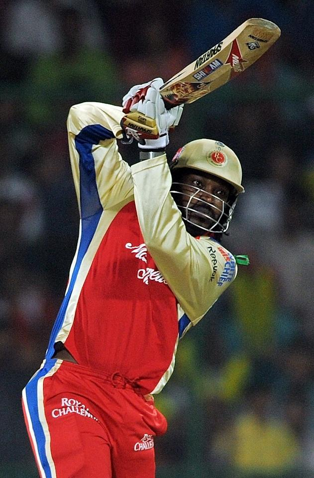 Royal Challengers Bangalore batsman Chris Gayle plays a shot during the IPL Twenty20 cricket match between Delhi Daredevils and Royal Challengers Bangalore at the Feroz Shah Kotla stadium in New Delhi on May 17, 2012.      RESTRICTED TO EDITORIAL USE. MOBILE USE WITHIN NEWS PACKAGE. AFP PHOTO/ MANAN VATSYAYANA         (Photo credit should read MANAN VATSYAYANA/AFP/GettyImages)