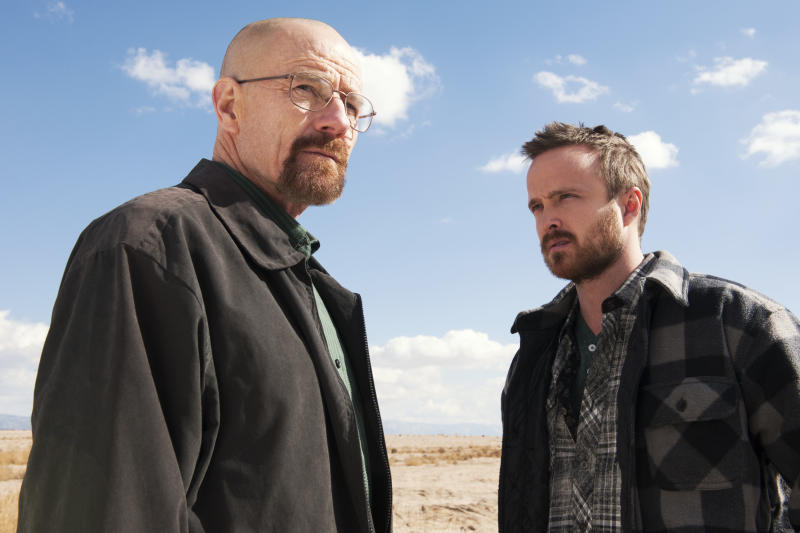 """This image released by AMC shows Bryan Cranston, left, and Aaron Paul in a scene from """"Breaking Bad."""" Paul is nominated for best supporting actor in a drama series for his role as Jesse Pinkman. The Academy of Television Arts & Sciences' Emmy ceremony will be hosted by Neil Patrick Harris. It will air Sept. 22 on CBS. (AP Photo/AMC, Frank Ockenfels )"""