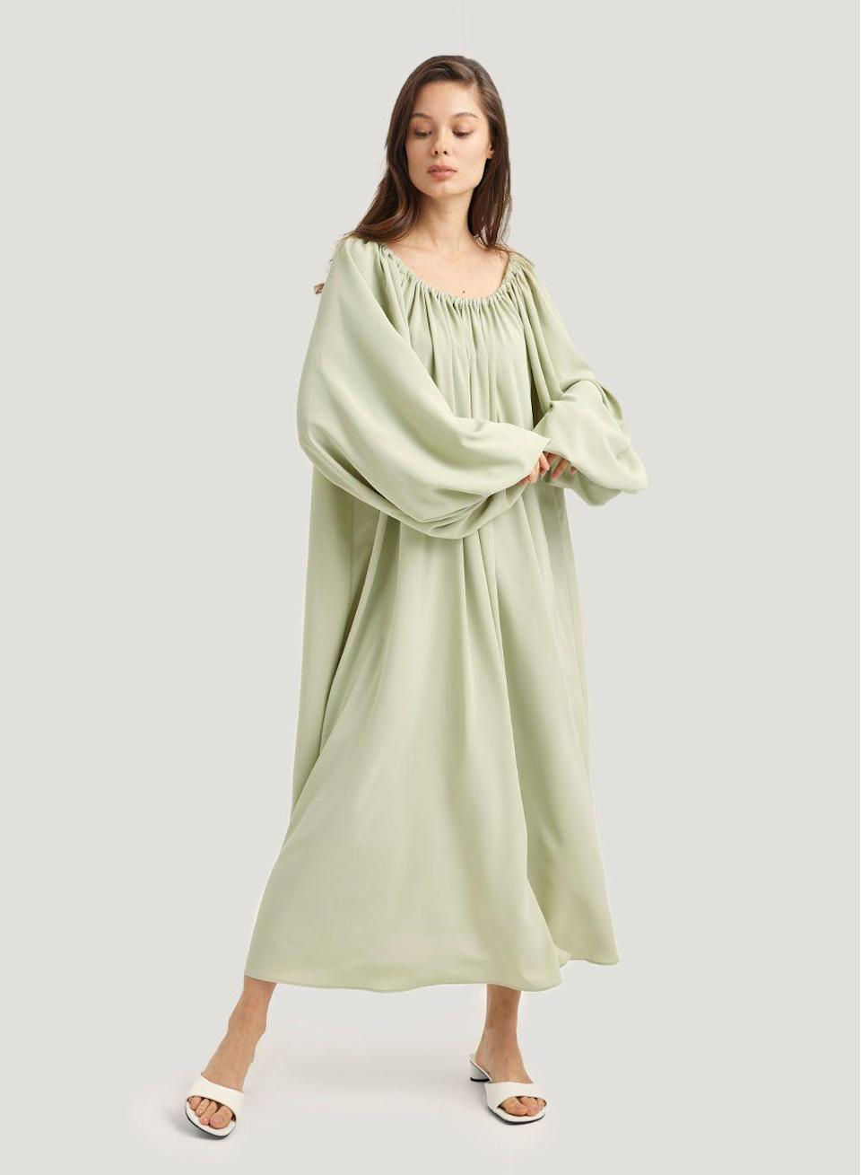 "<p><strong>Nap Loungewear</strong></p><p>naploungewear.com</p><p><strong>$98.00</strong></p><p><a href=""https://naploungewear.com/product/gypsy-puff-sleeve-dress/"" rel=""nofollow noopener"" target=""_blank"" data-ylk=""slk:shop it"" class=""link rapid-noclick-resp"">shop it</a></p><p>Looking for an effortless dress to add to your summer rotation? The billowing silhouette, puff sleeves, and ruched neckline have us feeling like we could do just about anything in this. Keep it simple with a pair of house slippers or dress it up with a elevated mule. </p>"
